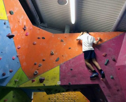 Young Person on Climbing Wall